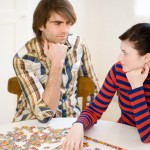 Couple with jigsaw puzzle